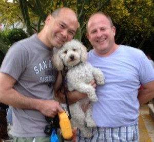 """Bill (right) with his partner Eric and their dog """"Teddy"""""""